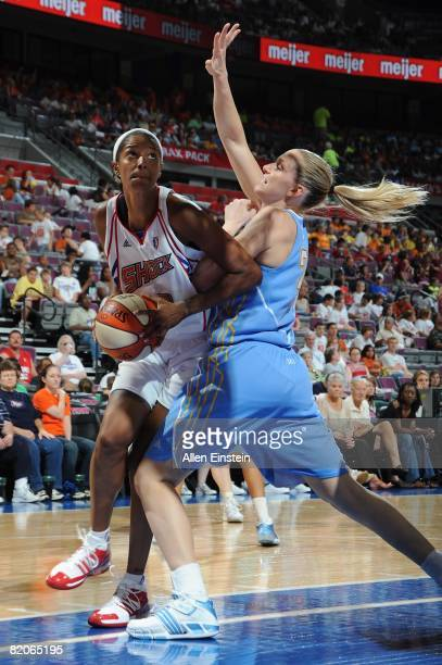 Stacey Lovelace of the Detroit Shock looks for the shot under pressure against Brooke Wyckoff of the Chicago Sky during the WNBA game on July 16 2008...