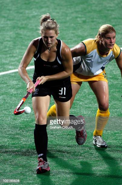 Stacey Michaelsonof New Zealand fights for possesion with Jennifer Wilson of South Africa during the Womens Hockey Semi Final Match 24 at Major Dhyan...