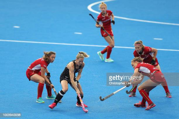Stacey Michelsen of New Zealand battles with the Belgium defence during the Pool D game between New Zealand and Belgium of the FIH Womens Hockey...