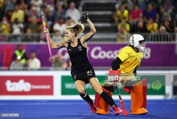 Stacey Michelsen of New Zealand celebrates victory after scoring last in the penalty shoot out during Women's Semi Final Hockey match between England...