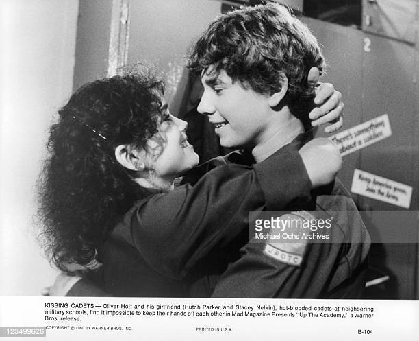 Stacey Nelkin has her arm around Hutch Parker as they smile at one another in a scene from the film 'Up The Academy' 1980