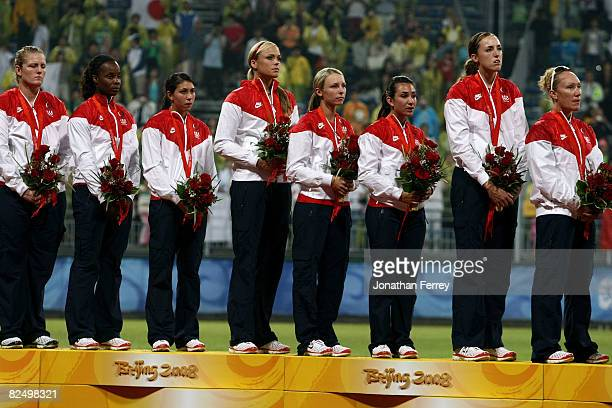 Stacey Nuveman Natasha Watley Andrea Duran Jennie Finch Caitlin Lowe Victoria Galindo Monica Abbott and Kelly Kretschman of the United States receive...