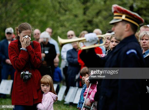 Stacey Patterson of Conover North Carolina cries while her daughter Bailey hugs her after her deceased fathers name was read during a ceremony at the...