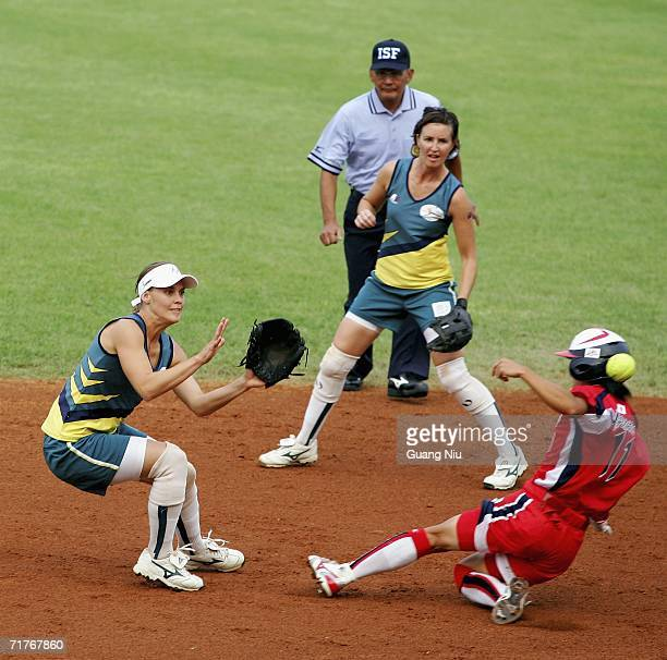 Stacey Porter of Australia waits for a ball as Eri Yamada of Japan runs to the seocnd the base during ISF XI Women's Fast Pitch Softball World...