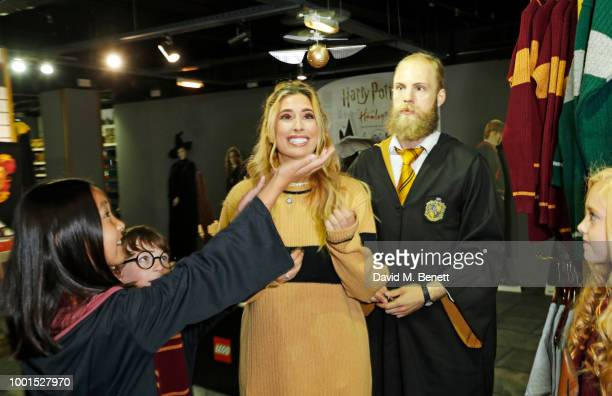Stacey Solomon and guests play with a flying snitch at the launch of The Wizarding World of Harry Potter at Hamleys on July 19 2018 in London England