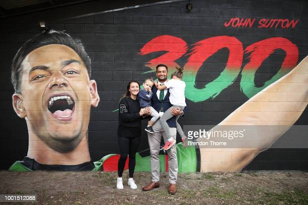 Stacey Sutton Ace Sutton John Sutton and Pippi Sutton pose in front of a mural commemorating John Sutton's 300th game for the Rabbitohs during a...
