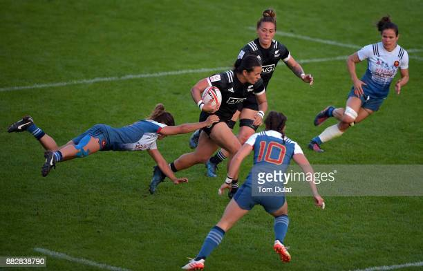 Stacey Waaka of New Zealand is tackled by Pauline Biscarat of France during the match between New Zealand and France on Day One of the Emirates Dubai...