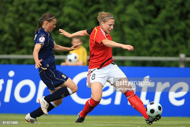 Stacey Williamson of Scotland and Kim Kulig of Germany fight for the ball during the Women's U19 European Championship match between Scotland and...