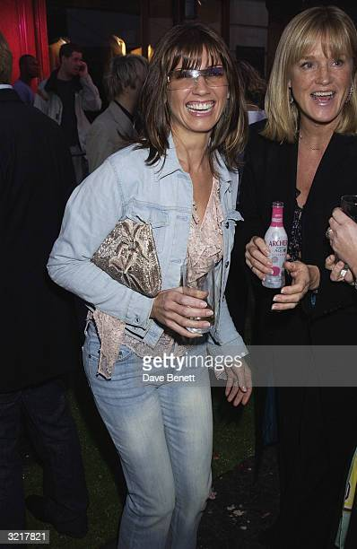 Stacey Young wife of singer Paul Young and her freind Elaine during the street party and collection preview in Saville Row on 12th February 2002 to...