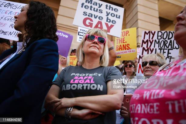 Staci Fox CEO and President of Planned Parenthood Southeast participates in a protest against recently passed abortion ban bills at the Georgia State...