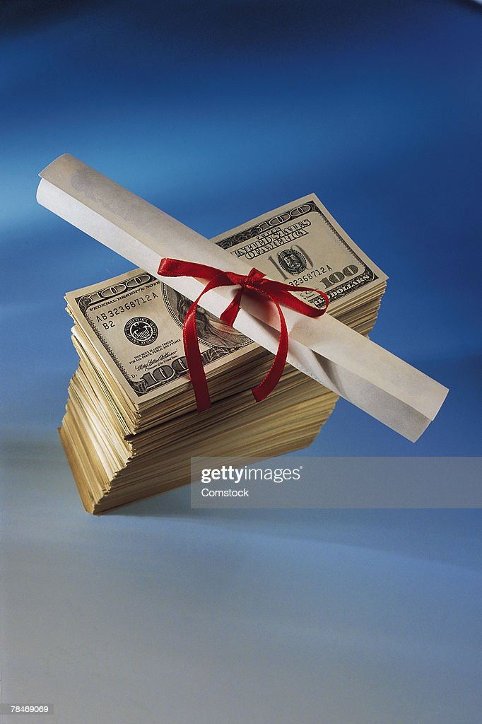 stack of dollar bills diploma on top stock photo getty  stack of 100 dollar bills diploma on top stock photo
