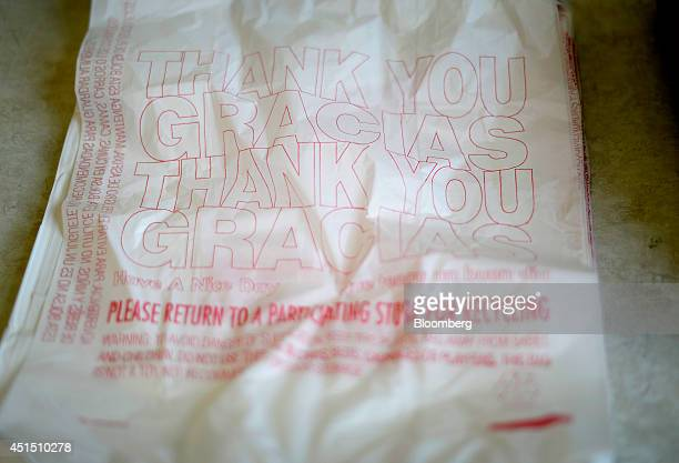 A stack of a singleuse plastic bags sit in a box at Sasoun Produce in Los Angeles California US on Tuesday June 24 2014 California grocers who could...