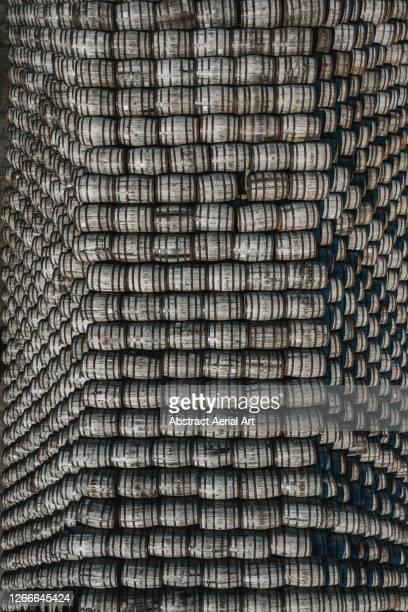 stack of alcohol barrels forming a pyramid shape photographed from directly above, scotland, united kingdom - overflowing stock pictures, royalty-free photos & images