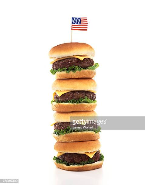 Stack of American hamburgers with the American flag on top