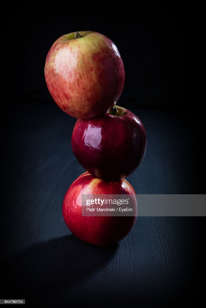 Stack Of Apples Against Black Background : Stock Photo