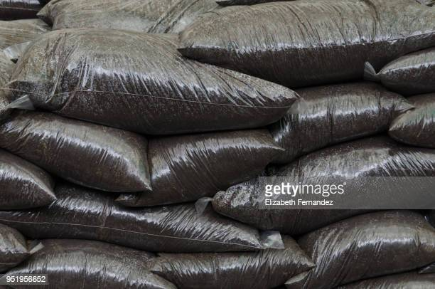 A stack of bags of Top Soil in a garden centre