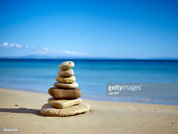 stack of balanced stones on the beach - alicante stock pictures, royalty-free photos & images