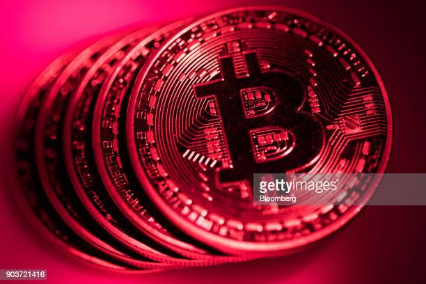 A stack of bitcoin tokens sit in this arranged photograph in London UK on Tuesday Jan 9 2018 On Wednesday billionaireWarren Buffettsaid on CNBC...