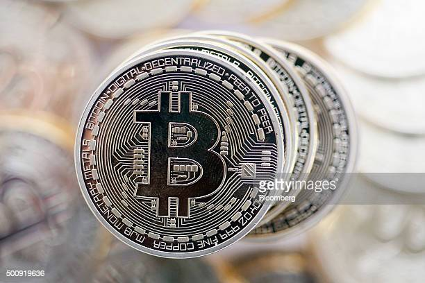 A stack of Bitcoins stand in this arranged photograph in Danbury UK on Thursday Dec 10 2015 Bitcoin the digital currency climbed on Wednesday to hit...