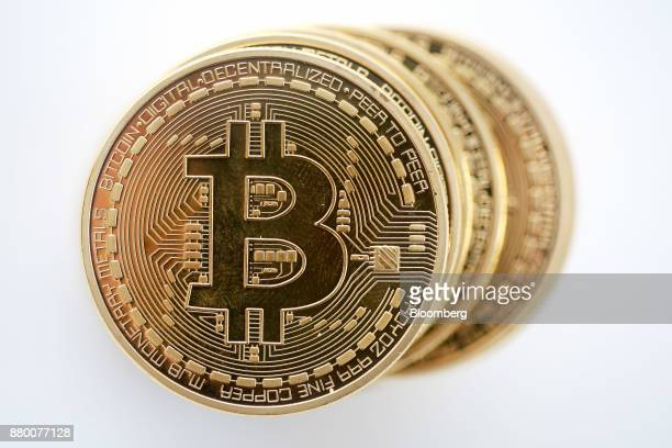 A stack of Bitcoins stand in this arranged photograph in Danbury UK on Thursday Dec 10 2015 Bitcoin is showing no signs of slowing down the price of...