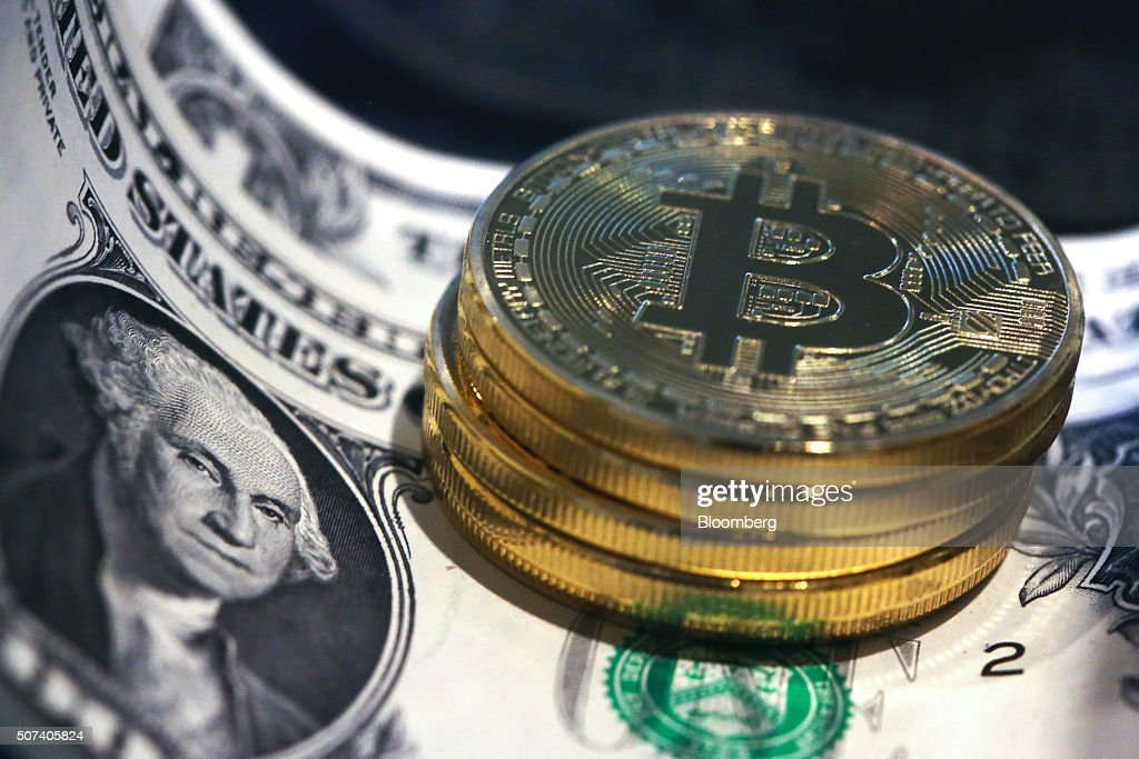 Bitcoins And U.S. Dollar Notes As IMF Vouches For Virtual Currencies : News Photo