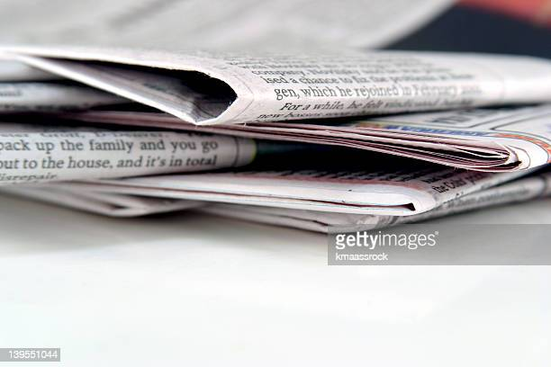 stack of blank and white ink newspapers - editorial stock pictures, royalty-free photos & images