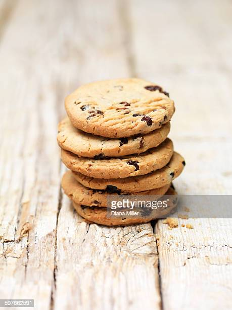 Stack of blueberry and oat cookies on wood