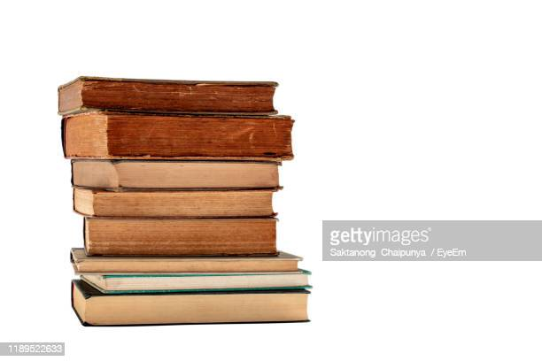 stack of books against white background - literature stock pictures, royalty-free photos & images