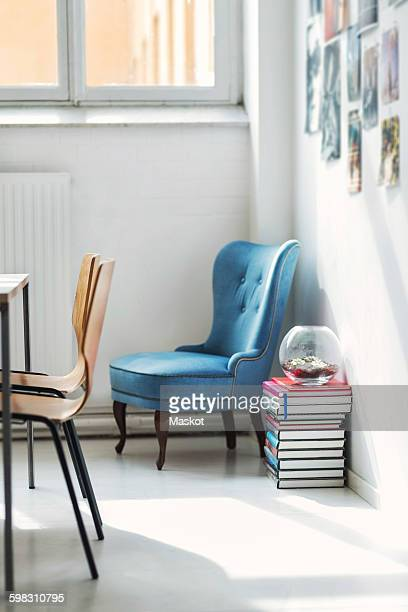 Stack of books and chairs in office