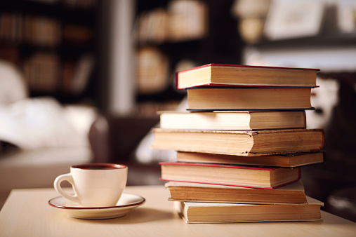 stack of books in home interior 532852345