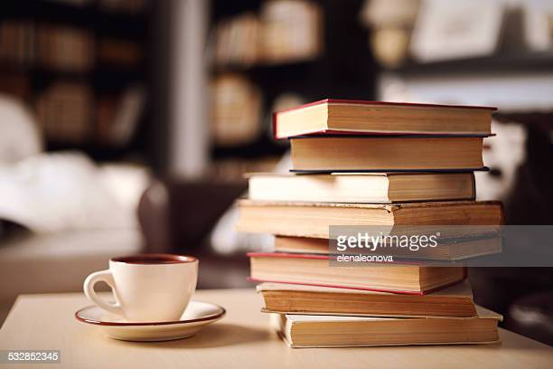 stack of books in home interior - boek stockfoto's en -beelden