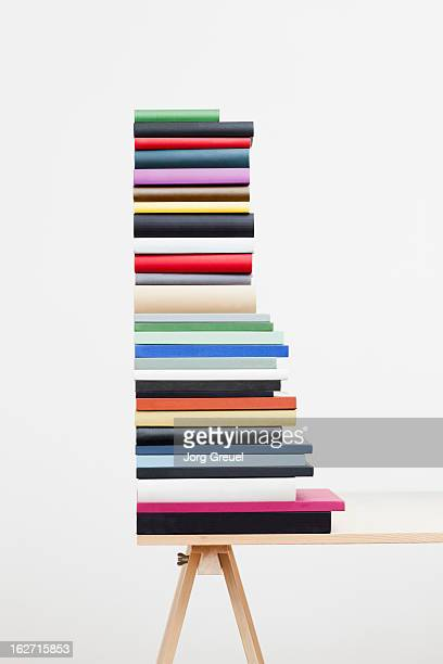 a stack of books on a table - neat stock pictures, royalty-free photos & images