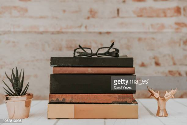 stack of books on rustic background. education concept. - 文学 ストックフォトと画像