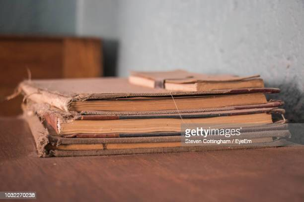 stack of books on table - steven cottingham stock-fotos und bilder