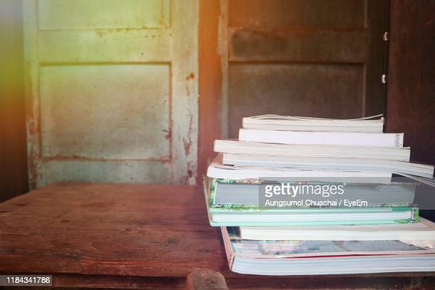 stack of books on table - aungsumol stock pictures, royalty-free photos & images