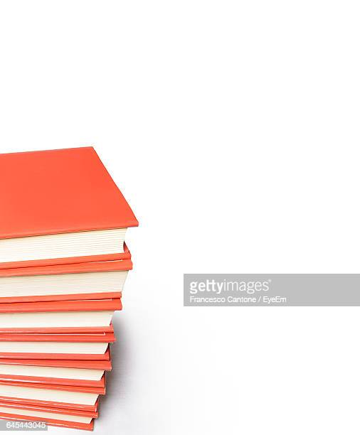 stack of books on white background - handbook stock photos and pictures