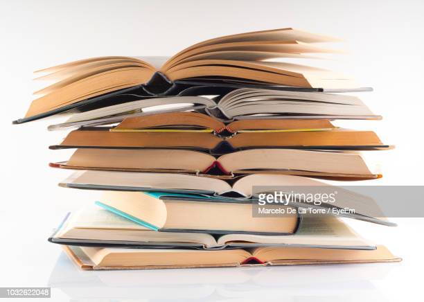 stack of books over white background - textbook stock pictures, royalty-free photos & images