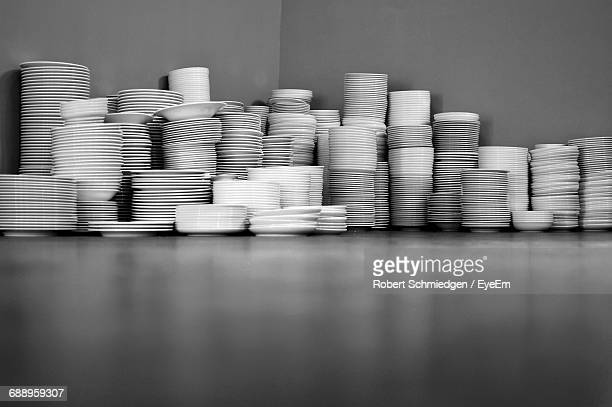 Stack Of Bowls And Plates Against Wall