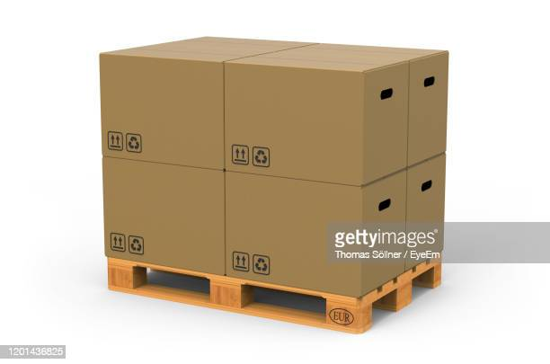stack of box against white background - storage compartment stock pictures, royalty-free photos & images