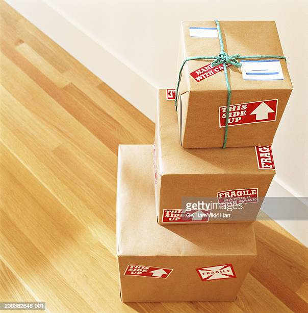stack of boxes labelled 'fragile - handle with care', elevated view - fragile sign stock pictures, royalty-free photos & images