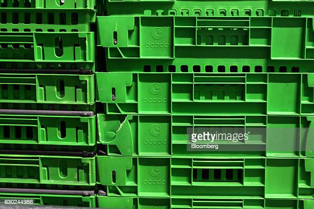 A stack of branded crates stand in the warehouse at the Ocado Group Plc distribution centre in Dordon UK on Friday Dec 16 2016 Ocado provides home...