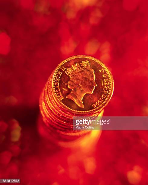 stack of british pound coins - kathy cash stock pictures, royalty-free photos & images