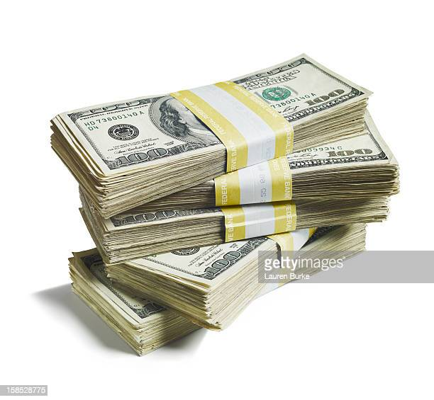 A stack of bundled of 100 US dollar bills