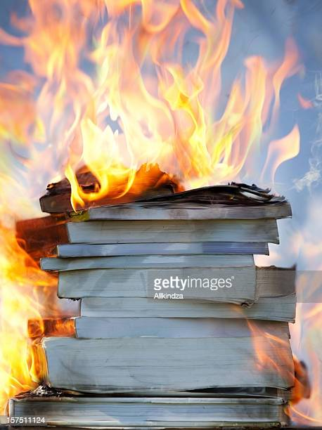 stack of burning books ii - book burning stock pictures, royalty-free photos & images