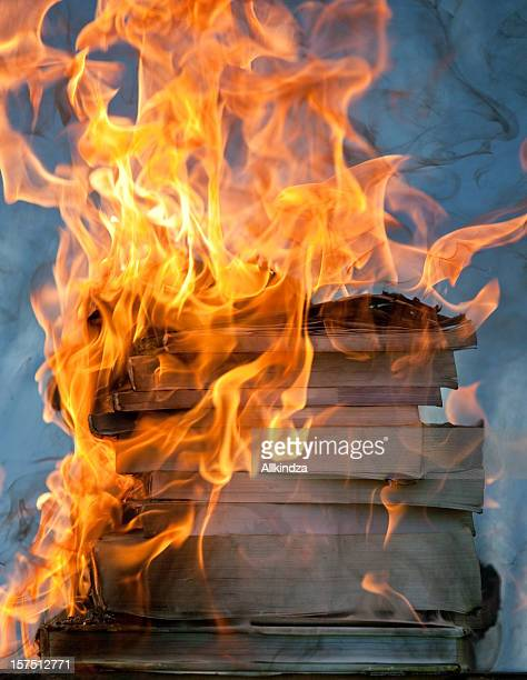 stack of burning books iii - book burning stock pictures, royalty-free photos & images