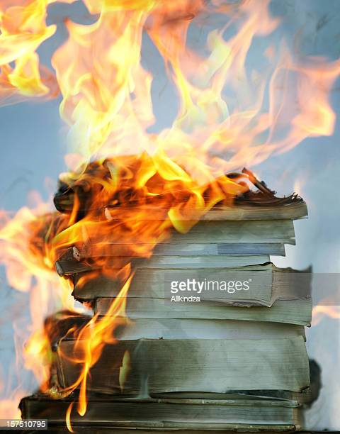stack of burning books - book burning stock pictures, royalty-free photos & images