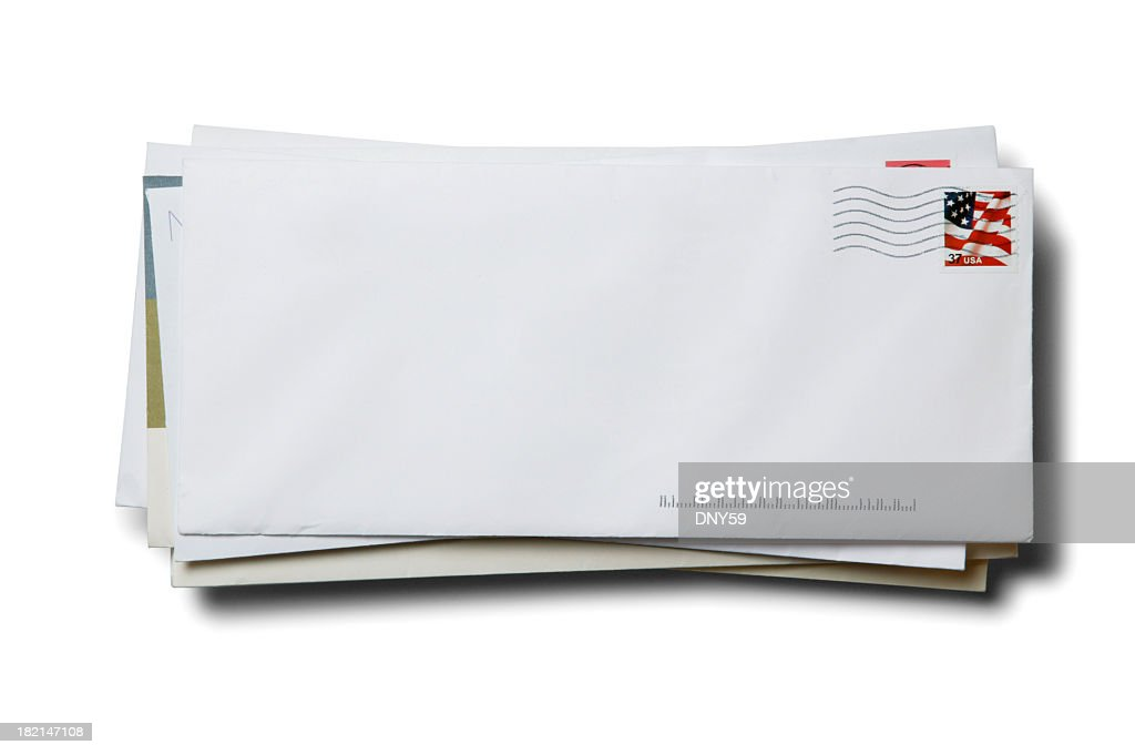 Stack of business envelopes with cancelled stamp on white background : Stock Photo