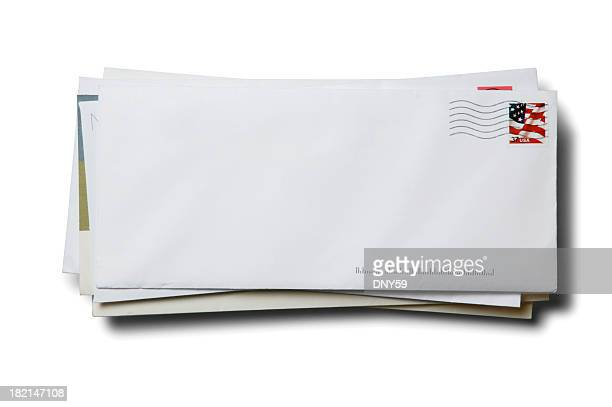 stack of business envelopes with cancelled stamp on white background - bericht stockfoto's en -beelden