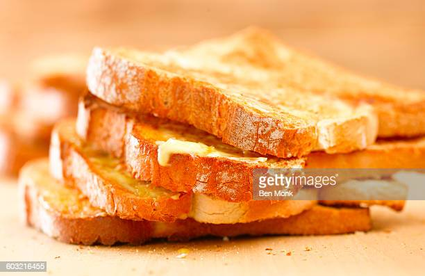 stack of buttered toast - butter stock pictures, royalty-free photos & images