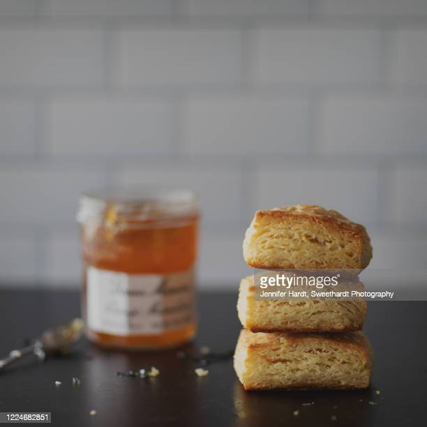 stack of buttermilk biscuits and jam jar - differential focus stock pictures, royalty-free photos & images